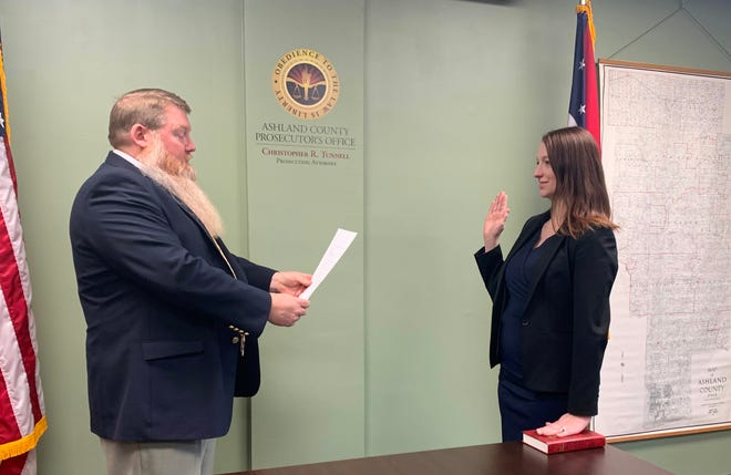 Ashland County Prosecuting Attorney Christopher R. Tunnell gives the oath of office to Stephanie Todaro, a new assistant prosecuting attorney for Ashland County.