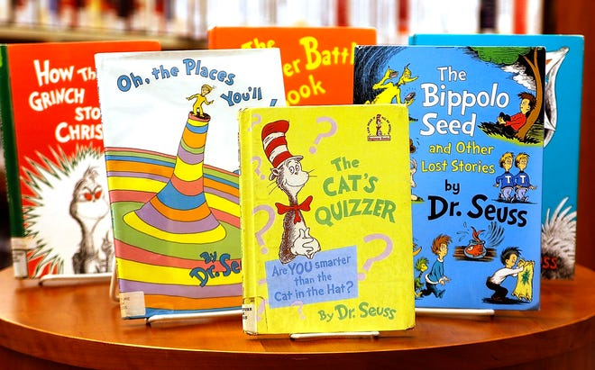 "The Ashland Public Library currently has five of the six Dr. Seuss books recently pulled from publication by Dr. Seuss Enterprises for having insensitive depictions of ethnic minorities, including ""The Cat's Quizzer,"" pictured at the library Friday. They will continue to be offered to patrons."