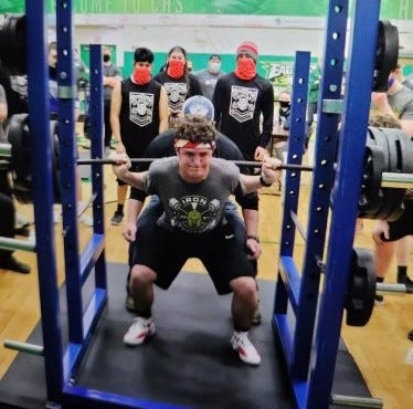 South Central's Braden Kiesel performs a squat while competing at a powerlifting meet at Oregon Clay on March 6.