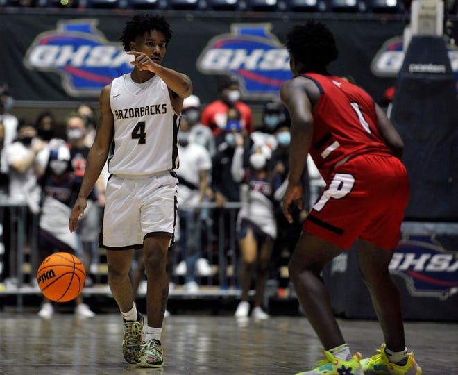 Richard Visitacion, left, dribbles the ball up the court during Cross Creek's state championship game against Sandy Creek on Friday, March 12, 2021 at the Macon Centreplex in Macon, Ga. [WYNSTON WILCOX/THE AUGUSTA CHRONICLE]