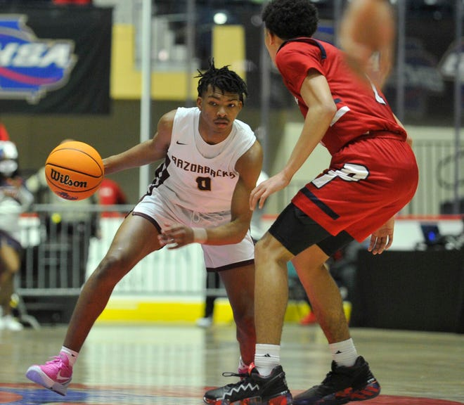 Devin Pope tries to dribble past a Sandy Creek defender during the state championship game on Friday, March 12, 2021 at the Macon Centreplex in Macon, Ga. [WYNSTON WILCOX/THE AUGUSTA CHRONICLE]