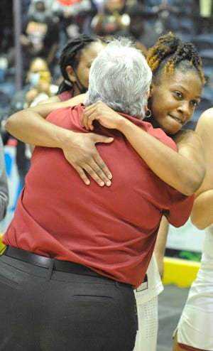Jordyn Dorsey, right, shares a hug with Kim Schlein after the Cross Creek girls defeated Greater Atlanta Christian School for the GHSA 3A state championship at the Macon Centreplex in Macon, Ga. [WYNSTON WILCOX/THE AUGUSTA CHRONICLE]