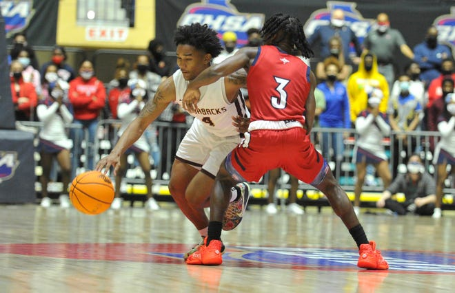 Richard Visitacion, left, gets past a Sandy Creek defender during Cross Creek's state championship game at the Macon Centreplex in Macon, Ga. [WYNSTON WILCOX/THE AUGUSTA CHRONICLE]