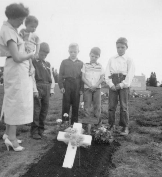 Members of the Patton family mourn at Patty's grave after she was buried. From left are Bernice Patton (holding Ron), Jim, Dave, Ken and Thomas, Jr.