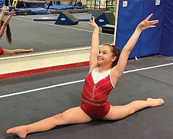 Bartlesville Gymnastics Club's Emma Jones powered to All-Around first place in her division during a recent competition.