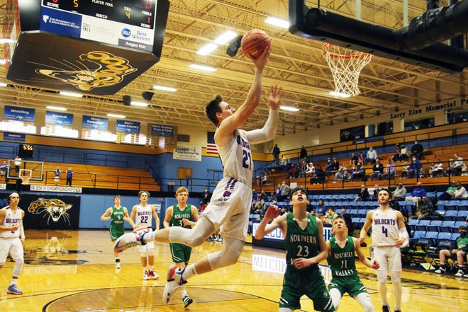 Hanover's Colin Jueneman (21) goes in for the layup after getting a steal in Friday's Class 1A-II state semifinal game at Barton Community College. Hanover won 85-58 to advance to their 10th state championship game.