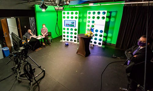Butler Alumnus Tom Mittlestadt, Executive Director of Community Advancement Mary Moon, and Vocal Music Instructor Dr. Henry Waters work in the campus television studio to livestream the 24th annual Butler Benefit Auction.