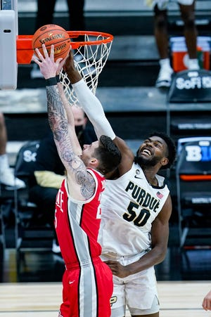 Ohio State forward Kyle Young, here getting his shot blocked by Purdue's Trevion Williams, has missed the past two games.