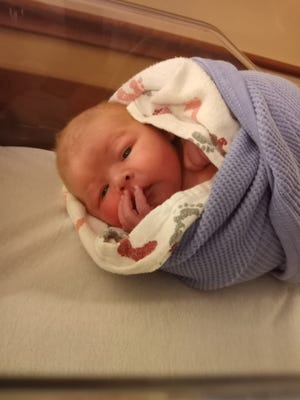 """Michael Wayne Hodge was born to Ashley Earnst and Jacob Hodge, March 4, 2021 at Graham Hospital. As his mom said, """"(He's) our little child of the quarn!"""""""