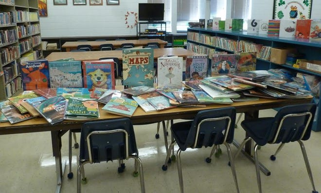 The Abingdon-Avon Elementary libraries received a $4,900 'Back to Books Grant' from the Illinois State Library.