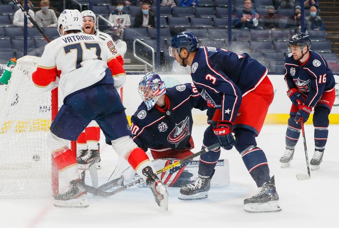 Florida Panthers center Frank Vatrano (77) scores the game-winning goal past Columbus Blue Jackets goaltender Elvis Merzlikins (90) during overtime of the NHL hockey game at Nationwide Arena in Columbus on Thursday, March 11, 2021. The Panthers won 5-4.