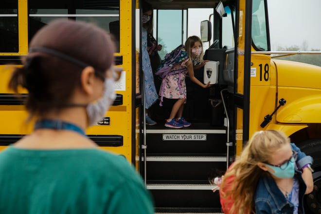 Olentangy schools' Board of Education has approved a one-year contract extension for the district's teachers. In this file photo, students get hand sanitizer as they step off the school bus during the first day of school on Sept. 1 at Heritage Elementary School in Lewis Center.