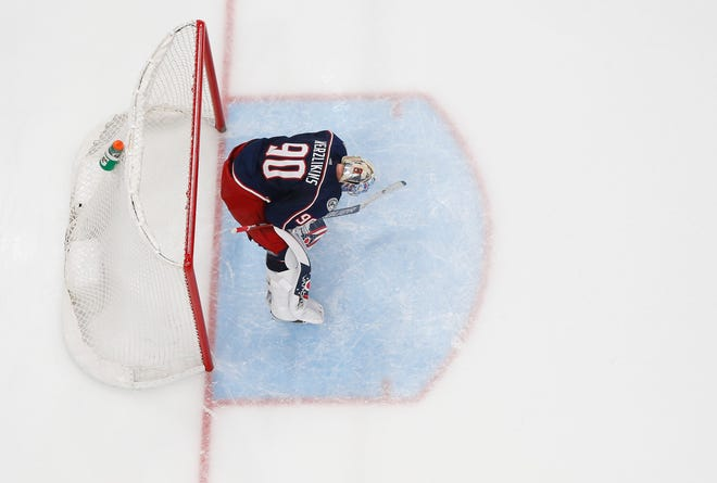 Goaltender Elvis Merzlikins (90) hangs his head after giving up a goal in the third period Thursday in the Blue Jackets' 5-4 overtime loss to the Florida Panthers.