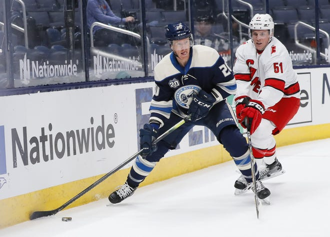 10-year NHL veteran Riley Nash, here looking to pass against Carolina on Feb. 7, has given some of the Blue Jackets' top scoring options a spark with his steady play.