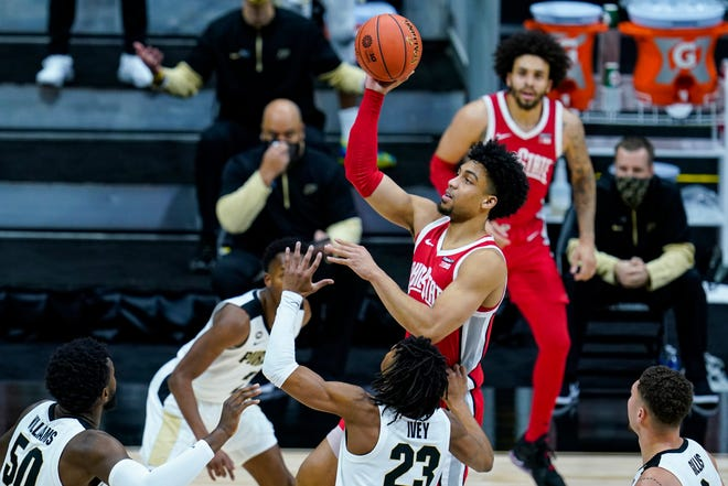 Ohio State forward Justice Sueing shoots over Purdue guard Jaden Ivey on Friday.  The Buckeyes will face Michigan in a Big Ten semifinal on Saturday.