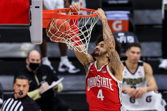 Mar 12, 2021; Indianapolis, Indiana, USA; Ohio State Buckeyes guard Duane Washington Jr. (4) dunks the ball against the Purdue Boilermakers in the first half at Lucas Oil Stadium. Mandatory Credit: Aaron Doster-USA TODAY Sports
