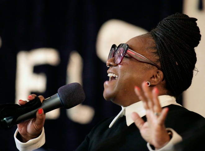 """Pastor Priscilla Woodson sings at a memorial gathering for Robert """"Babachu"""" Spriggs on Thursday at Miracle Cathedral on the Near East Side."""
