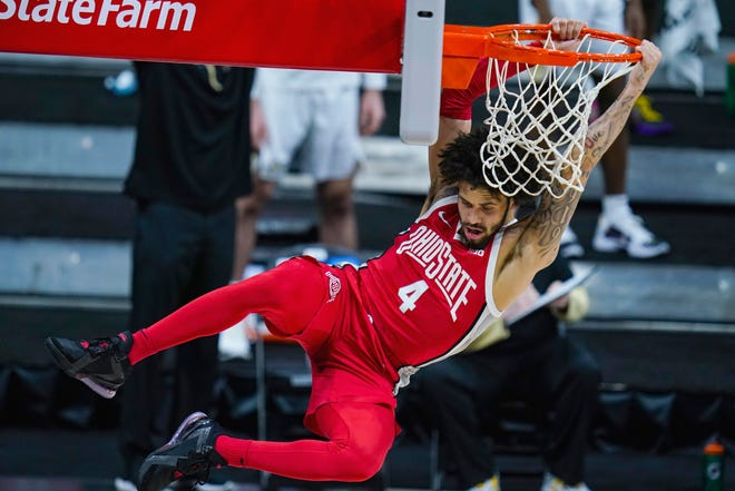 Duane Washington Jr., seen here dunking against Purdue, will stay in the NBA draft and not return to Ohio State.