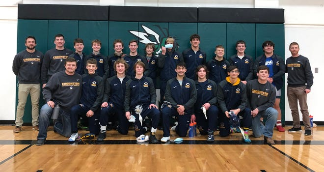 The Crookston wrestling team after their Section 8A Semifinal win against Frazee on Thursday. The Pirates won the Section 8A championship Saturday in Cass Lake.