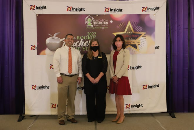 2022 Rookie Teacher of the Year Theresa Spann, center, with Umatilla High School Principal Thomas Gerds and Lake County Schools Superintendent Diane Kornegay.