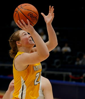 Waynedale guard Brooklyn Troyer tries to score in the paint against Ottawa-Glandorf. The senior scored 16 points for Waynedale in the loss.