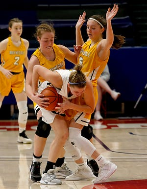 Waynedale guards Brooklyn Troyer (left) and Laney Murphy play defense during the Div. III state semifinals against Ottawa-Glandorf.
