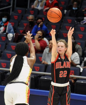 Hiland's Kyli Horn with a clutch three pointer over Purcell Marian's Leah Smith.