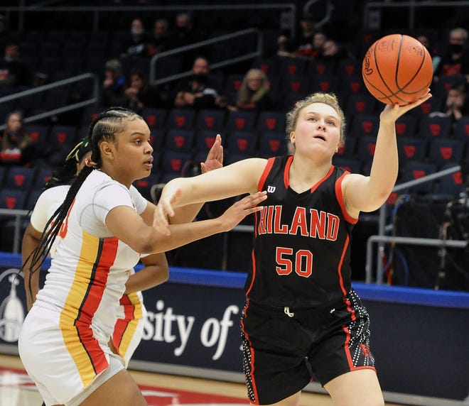Hiland's Zoe Miller puts up this left-handed shot over Purcell Marian's Janay Rose.