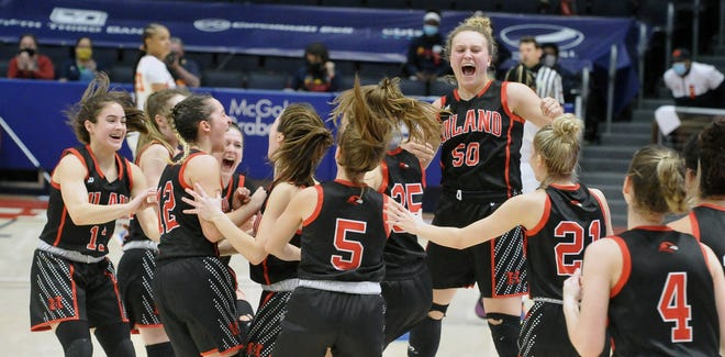 Zoe Miller (50) jumps for joy, celebrating with her teammates while clinching a state title berth.