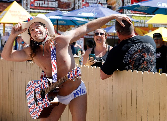 Naked Cowboy returns to Main Street during Bike Week in Daytona Beach, Friday, March 12, 2021.