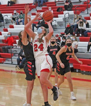 Coldwater freshman Mackenzie Scheid (24) returned from injury to play her first game at the varsity level Thursday. Scheid scored her first varsity points in the Cardinal effort, ending with four.