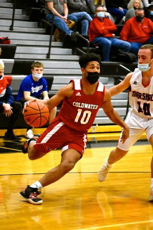 Coldwater's Deandre Douglas, shown here driving to the bucket versus Marshall, led the Cardinals to a win over Northwest on Thursday night