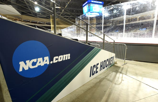 Banners are hung at Erie Insurance Arena on Friday, in preparation for the NCAA women's hockey quarterfinals and Women's Frozen Four hockey tournament March 15-20.