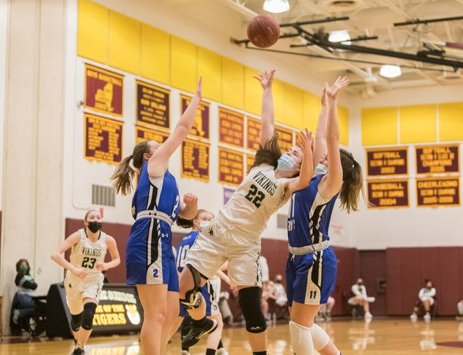 Avoca/Prattsburgh's Riley Stowe (22) fights for the layup through contact on Thursday evening in Avoca.