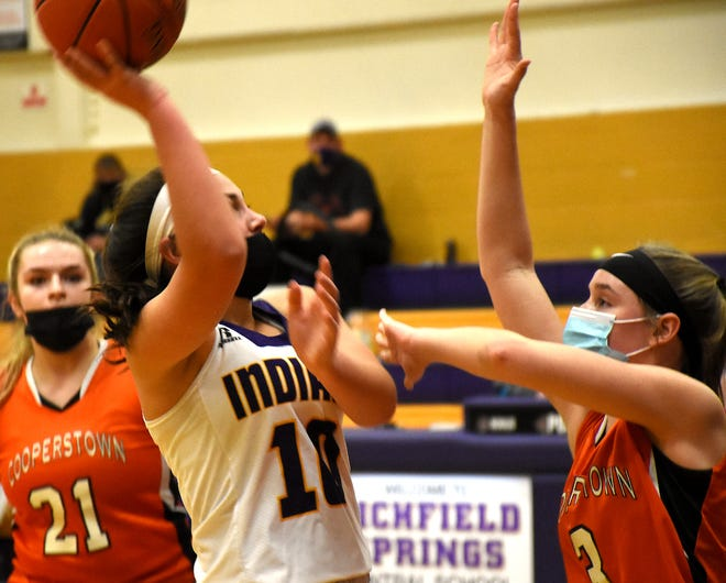 Maggie Worobey of Richfield Springs shoots over Cooperstown defender Addy Lewis (right) during the first half Thursday.