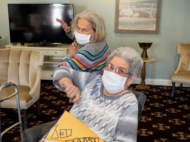 "Ann Knight (left), 81, and Dorothy ""Dot"" Tadlock, 88, share their stories at Elmcroft of Timberlin Parc, an assisted-living center in Jacksonville. Their friendship helped them during the harder months of 2020, during lockdowns and after Knight's husband died."