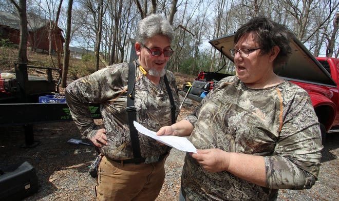 Tony Reed and Bonnie Wyandt looks over an earlier site plan for the future Valor Village off Vermont Street in Shelby Friday afternoon, March 12, 2021.