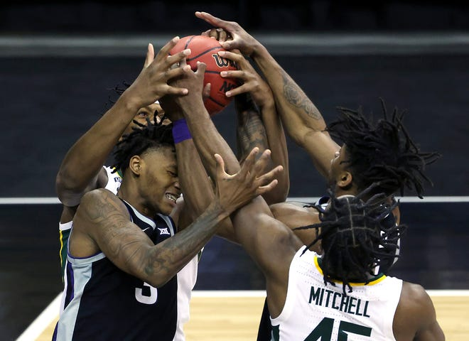 DaJuan Gordon #3 of the Kansas State Wildcats and Davion Mitchell #45 of the Baylor Bears compete for a rebound during the quarterfinal game of the Big 12 basketball tournament at the T-Mobile Center on March 11, 2021 in Kansas City, Mo.