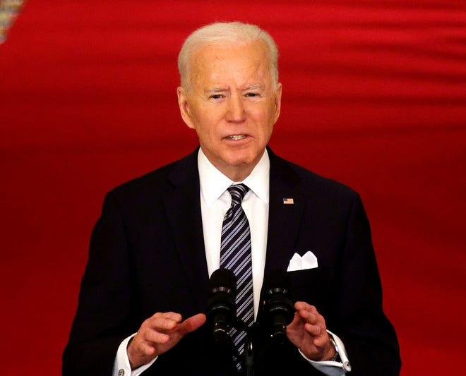 President Joe Biden delivers an address to the nation from the East Room of the White House in Washington, D.C., on Thursday. President Biden gave the address to mark the one-year anniversary of the shutdown due to the COVID-19 pandemic.