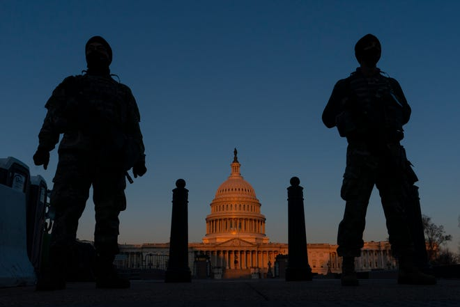 National Guard stand their posts around the Capitol at sunrise in Washington. Farmers Union Enterprises is donating $50,000 to provide 5,000 meals to soldiers.