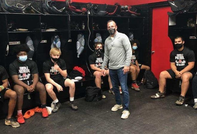 Former Bruce Drysdale Elementary principal BJ Laughter gives a devotional to a football team recently.