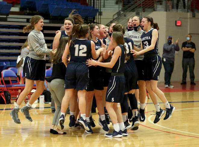 Sabetha celebrates their 57-55 win over Hugoton during the KSHSAA Class 3A State semi-final game at the Sports Arena Thursday, March 11, 2021.  Sabetha advances to the championship game and will play Cheney on Saturday at 2 p.m.
