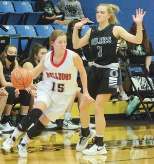 Golden Plains senior Brooke Stoll, left, tries to get around Central Plains sophomore Brynna Hammeke during play Thursday in Great Bend. Stoll scored 14 points in a loss to the Oilers in the state semifinals.