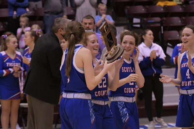 Scotland County seniors Kylee Stott, Kilee Bradley-Robinson and Morgan Blessing hold the team's fourth-place trophy Friday at the Hammons Student Center.