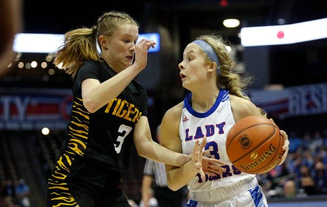 Scotland County Lady Tigers Hannah Feeney drives to the basket around Wellington-Napoleon Tigers Bree Shannon during a state semifinal matchup on Thursday, March 11, 2021, at JQH Arena.