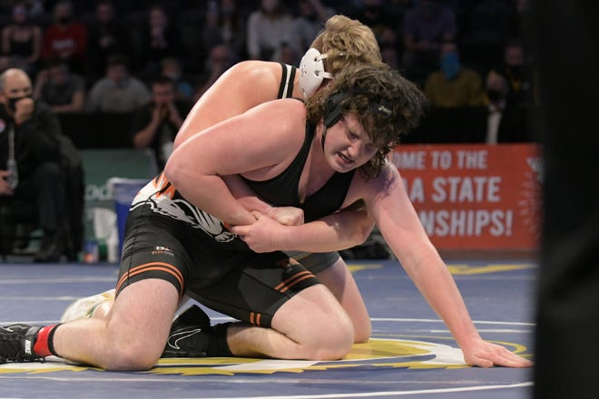 Kirksville's Bryce Kertz tries to escape from under Cameron's Camren Hedgpath during a semifinal match at the 2021 MSHSAA Wrestling Championships.