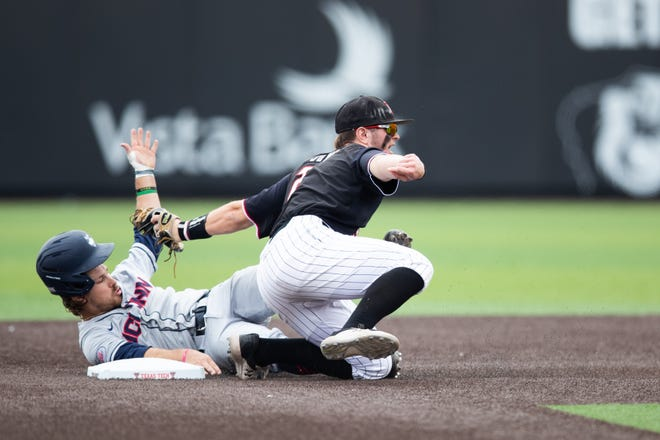 Texas Tech's Jace Jung attempts to tag a runner at second base during a nonconference game March 12 against UConn at Dan Law Field at Rip Griffin Park. Jung leads the Red Raiders with 15 home runs and 50 RBI which ranks him in a three-way tie for first and tied for first, respectively, in each category.
