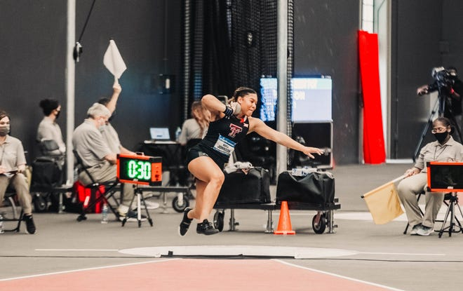 Texas Tech's Kayli Johnson throws the shot put Friday at the NCAA indoor track and field championships in Fayetteville, Arkansas. Johnson finished eighth, earning first-team all-America status for the first time in her career.
