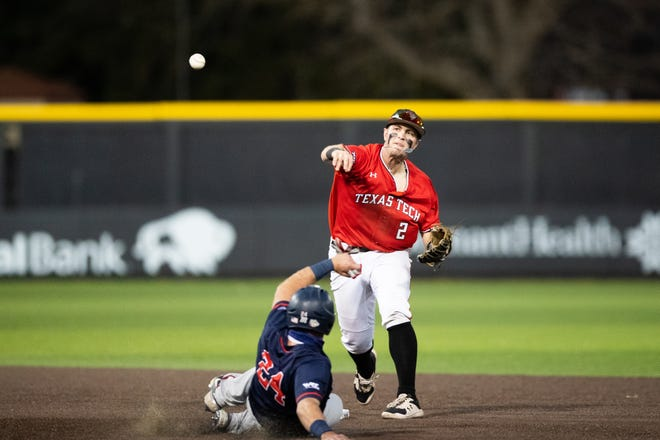 Texas Tech second baseman Jace Jung attempts to throw a ball as Gonzaga's Jack Machtolf slides into the base during a nonconference game Wednesday, March 10, 2021, at Dan Law Field at Rip Griffin Park.