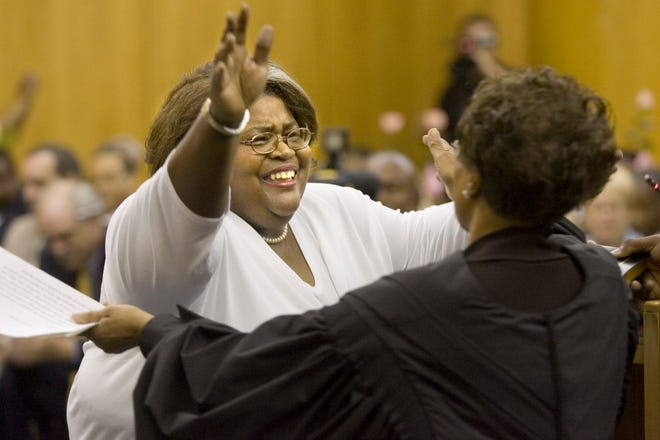"Newly invested Circuit Judge Karla Foreman Wright, left, throws her arms up to embrace Florida Supreme Court Justice Peggy Quince after Quince administered the oath during an investiture ceremony at the Polk County Courthouse in 2006. Wright, the first Black woman to preside as a judge in the 10th Judicial Circuit, is one of the local women featured in a Smithsonian poster exhibit, ""Picturing Women Inventors,"" currently on display at the Polk County Administration Building, 330 W. Church Street., Bartow."